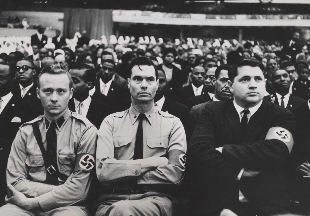 American Nazi Party founder George Lincoln Rockwell (center) attends a Nation of Islam summit in 1961