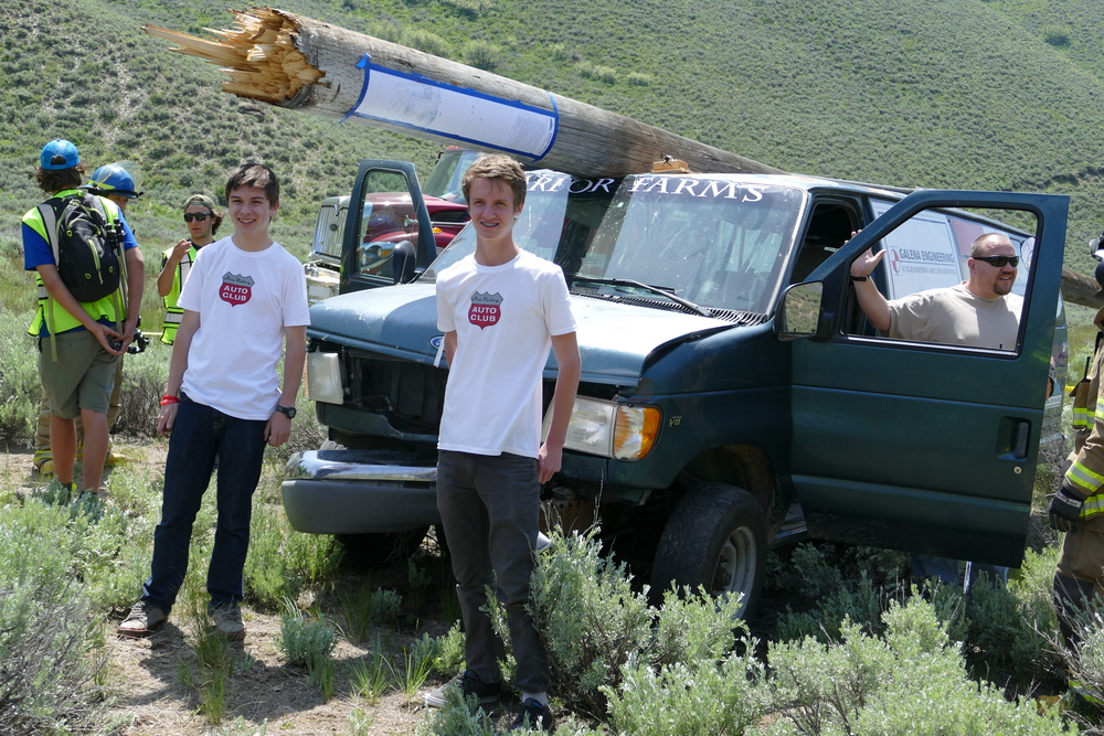 My collaborator, Joseph Anderson (left) and I posing in front of the van after hitting a telephone pole at around 45 mph.