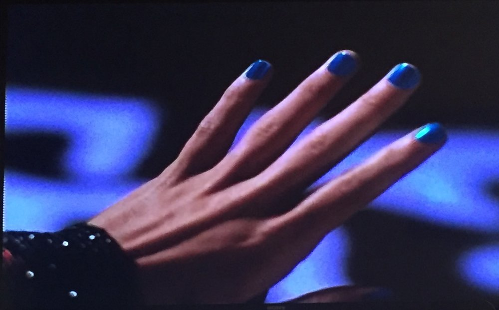 Check out those CGI electric blue nails!