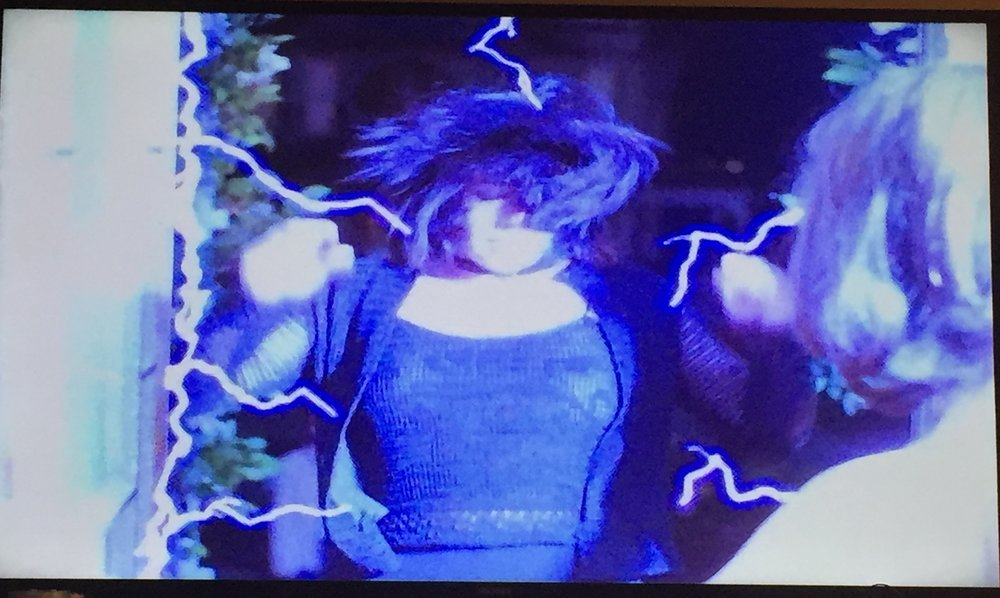 Prue gets hit with some illuminating electricity...