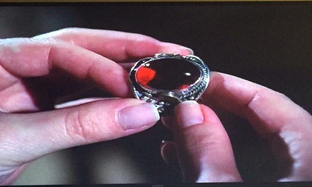 Close up of that gaudy ring.