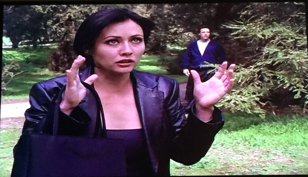 Prue using her hands to channel her power for the first time.