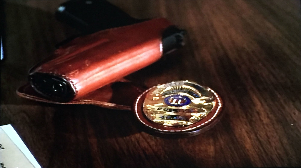 Andy's gun and badge.