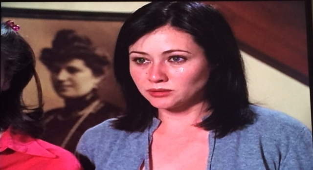 Prue cries as she reads the spell to accelerate time.