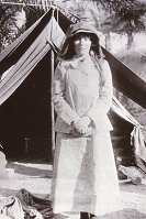 Gertrude Bell outside her tent, possibly in Babylon April  1909. Catalogue number K218.