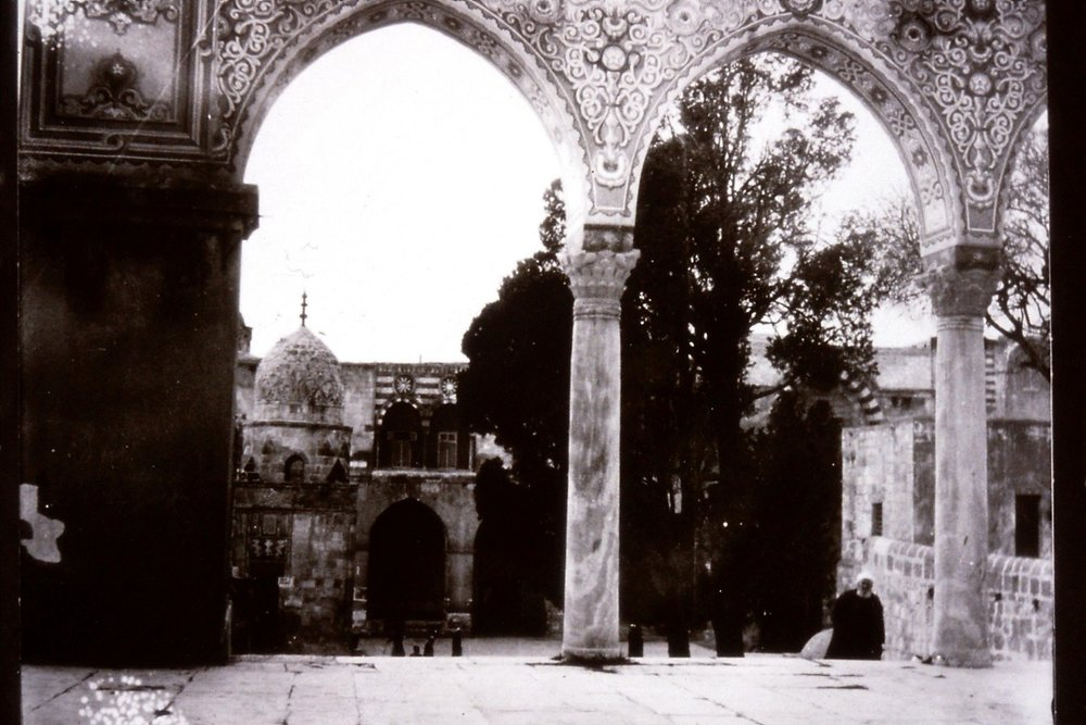 Gertrude Bell's photograph of view through decorated archways, December 1899. Catalogue number A52.