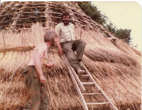 Steve and Howell, thatching the first roundhouse at Castell Henllys 1981, using Welsh reed