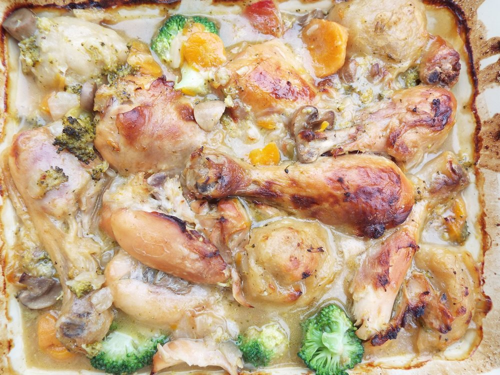 Chicken Casserole - Bake chicken drumsticks in the oven on a large tray. When chicken looks cooked, after about an hour, add chopped onions, seasoning, and vegetables to hand, stock, and potatoes /  dumplings.This meal uses carrots, garlic, broccoli, mushrooms, and dumplings from a packet mix.Cover with foil and bake for another hour or so.