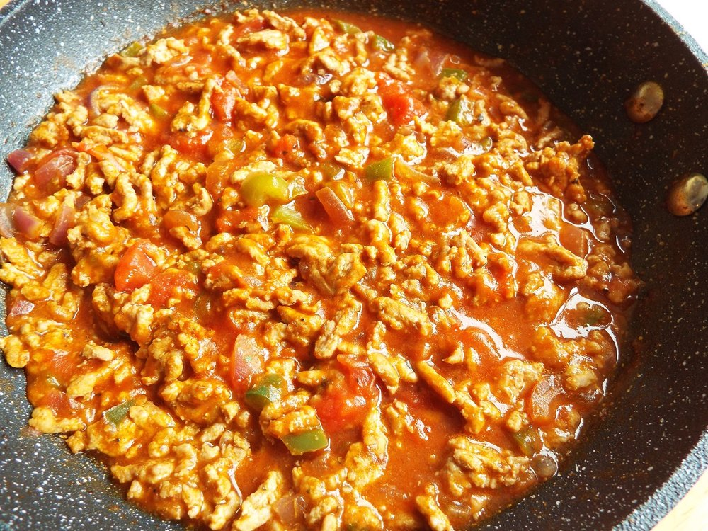Vegan Bolognese - I used a supermarket soya 'mince' - soak for a minute in boiling water before use. I added it to fried onions, grated carrot, chopped peppers and mushrooms, and stirred in some garlic granules, mixed herbs and seasoning.Finally I tipped in some canned tomatoes and simmered. Ideas about how to use it (cheaply) are below.You can use lentils instead of soya mince (which are also gluten-free).Vegan; vegetarian; health-aware