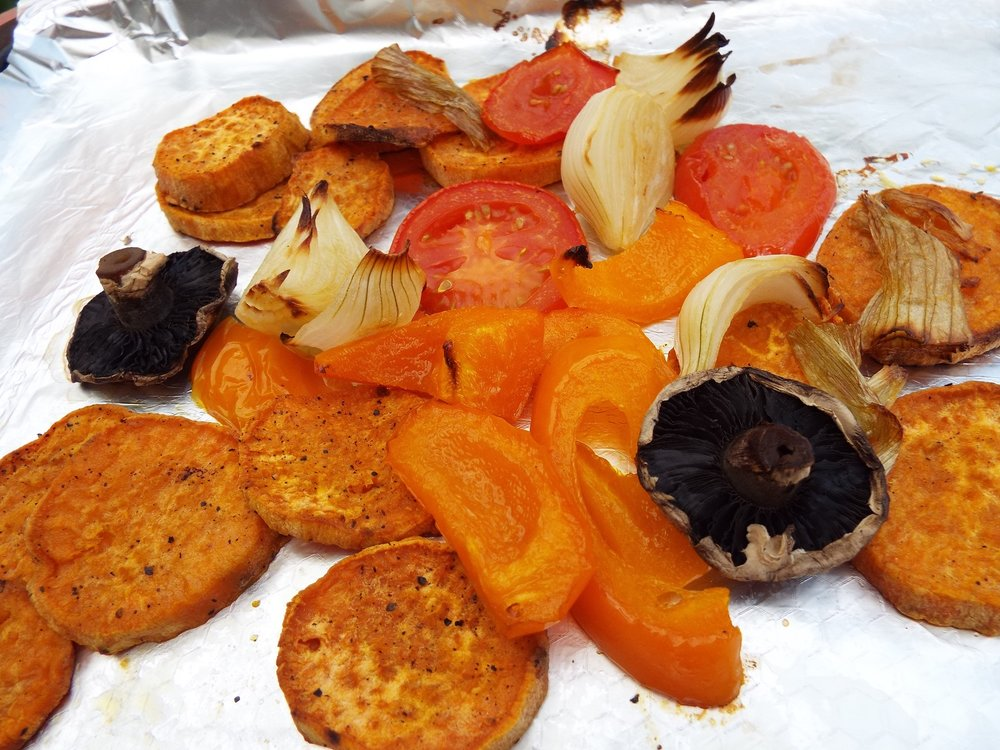 Roast Vegetables - Basically, chop a load of vegetables and drizzle them with a little olive or vegetable oil - then stick them in the oven and roast them for 45-60 minutes. These are sliced sweet potato, spring onion, orange capsicum, tomato and mushroom.Great side dish.Vegan; vegetarian; gluten-free; health-aware