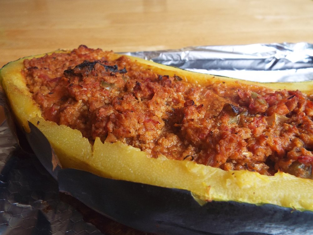 Marrow stuffed with Vegan Bolognese - I've chosen marrow because they're cheap in summer (and I grow them!), but you can also use squashes or aubergines (egg plants), or big baked sweet potatoes or regular potatoesSlice the marrow length-ways and scoop out seeds. Bake for 30 minutes. Fill with vegan bolognese mixture and bake again for 20-30 minutes. Serve hot.Vegan; vegetarian; health-aware