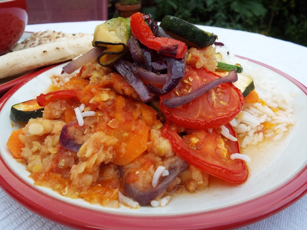 Vegetable Stack - This is basically lentil soup, simmered down, served on rice as a sauce, with a topping of ratatouille and fresh sliced tomatoes.Served here with flat bread.Vegan; vegetarian; gluten-free (if no flat bread); health-aware