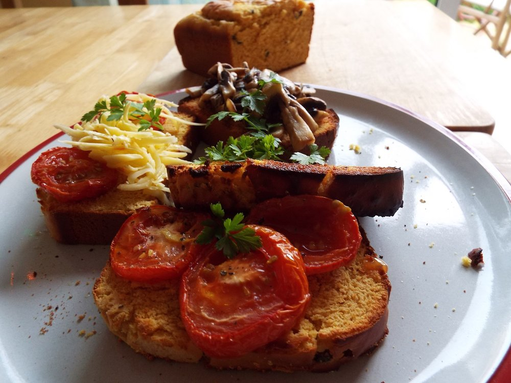 Gram flour loaf with black olives, toasted with tomatoes, mushrooms, vegan cheese - olive oil and parsley optional