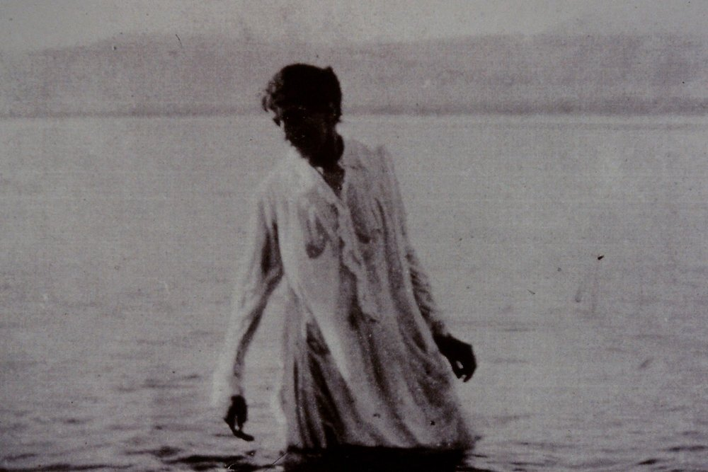 Gertrude Bell, Photographer - from Jerusalem to the Dead Sea - A particular photograph in Gertrude Bell's collection, taken in her very early years as a travel photographer, has drawn me back to it many times. It's an image of a European woman bathing in the Dead Sea in Palestine - then part of the Turkish Ottoman Empire - wearing full Victorian bathing gown and looking for all the world like she's in a state of rapture rather than in a harsh and unforgiving viscous lake of salt which burns like fire in your eyes and scorches even the slightest graze. It's not a typical formal Bell view of a building or a place - it's a thoughtful, intriguing composition.