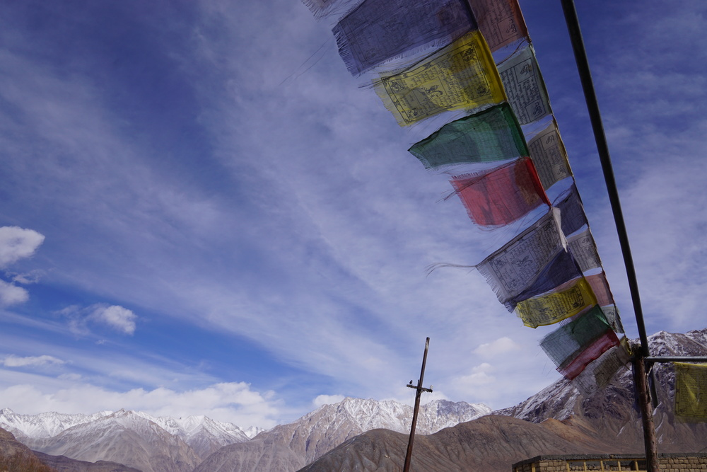The fluttering prayer flags - a sight to behold while I finish that second bowl of maggie.