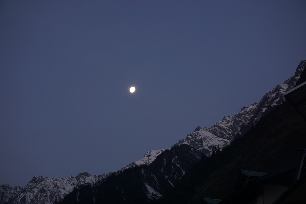 moon riding high in the himalayan sky. signs of clear beautiful skies