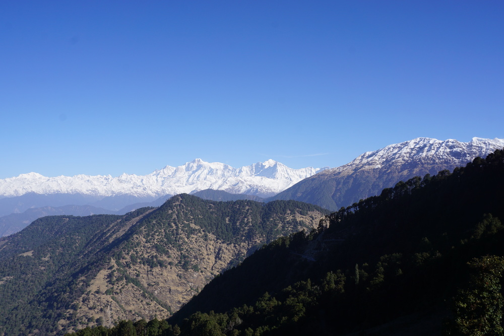 The imposing Himalayan range of the highest peaks - Nanda Devi and Chaukamba all viewed from this precious looking home stay at Chopta while trekking in the indian himalayas