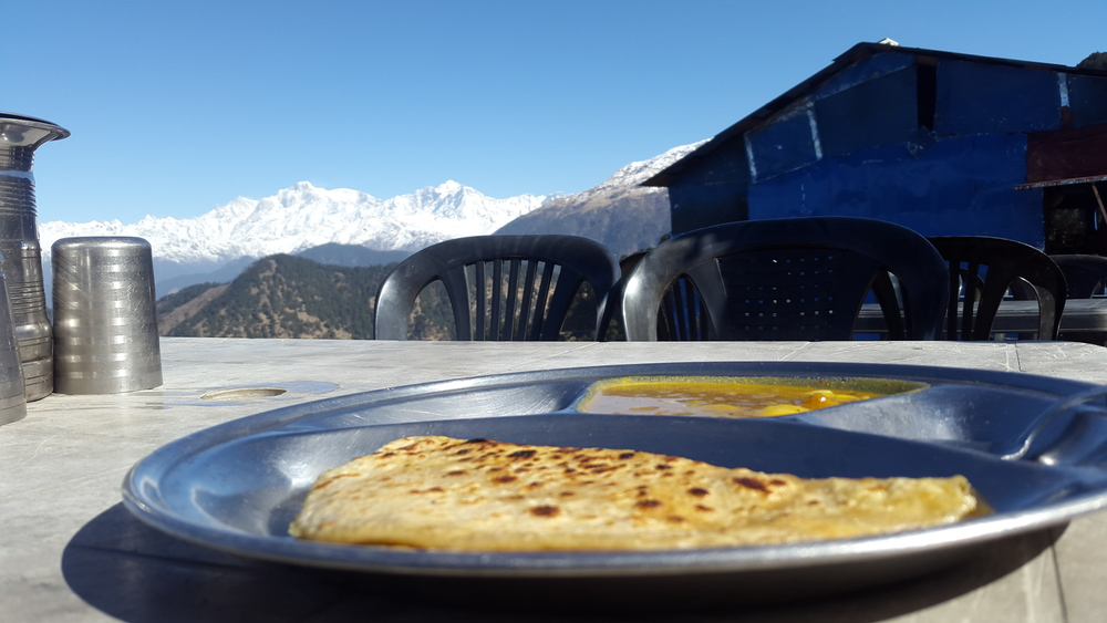 The parathas and hot steaming daal with the perfect view of the Himalayas. You can't replicate the same experience anywhere in the world except here when trekking in the indian himalayas.