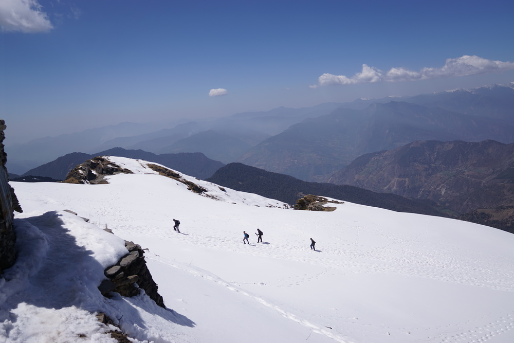 And in moments, I turned around and gasped. That was me just moments ago climbing through the steepness of the mountains, and we still have more to climb up towards chandrashila