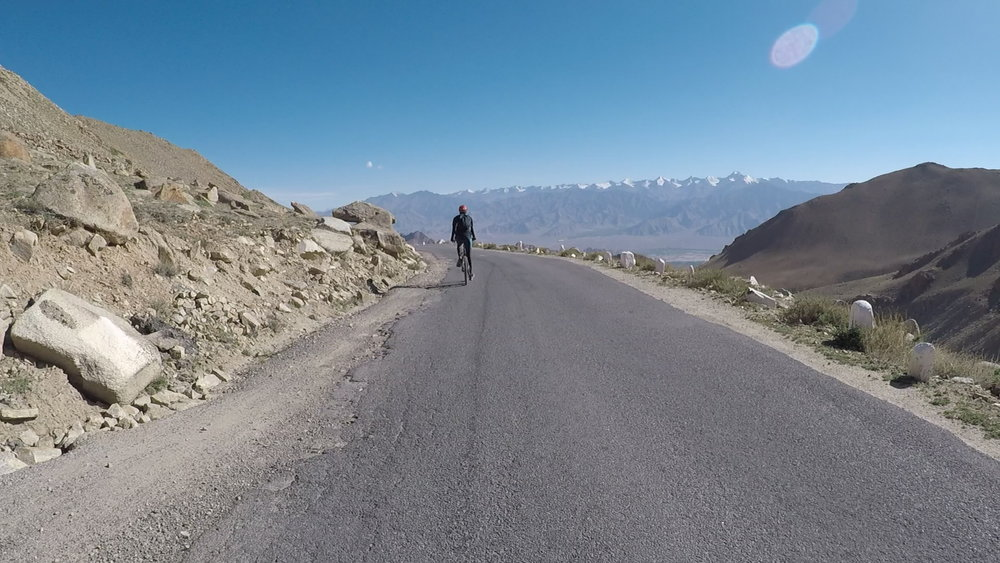 Riding as far as we could to get a view of the Stok range while cycling the highest motorable road in the world