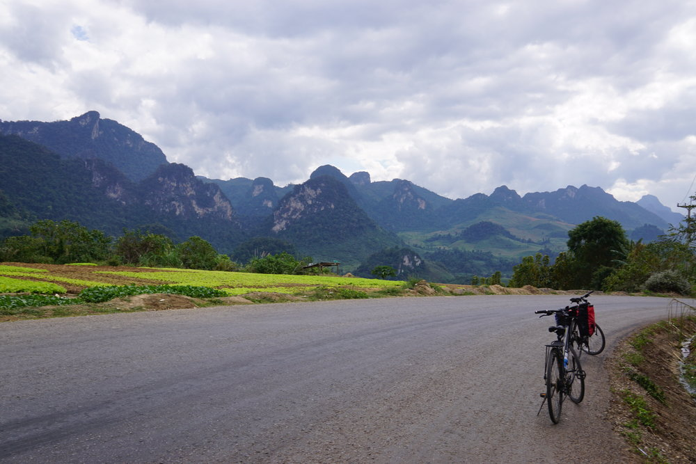 Cycling the back country roads in Laos, one of the best places to travel in January and December