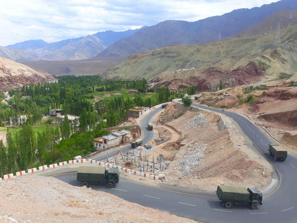 army trucks making their way downwards on the leh to srinagar highway while we scramble upwards