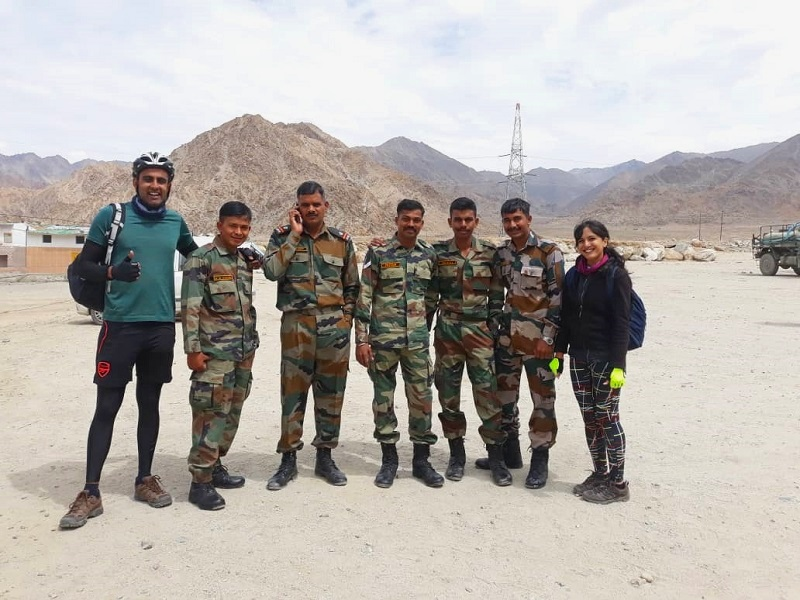 a photo opportunity with the hardworking army personnel in ladakh on our cycling break in india
