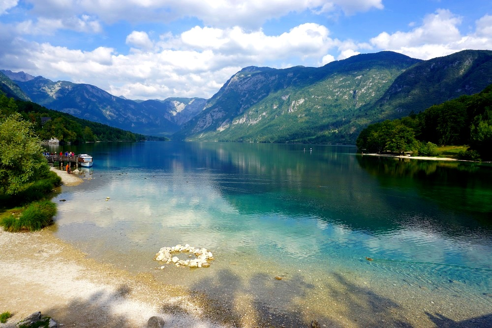 Take a book, relax and read by Lake Bohinj. Not a soul in sight.