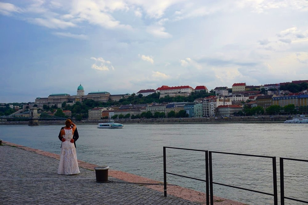 A couple having a moment together at the Danube waterways in Budapest.