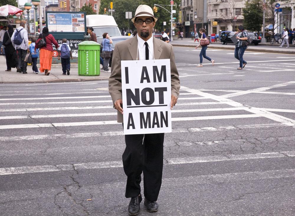 Dread Scott,  I Am Not a Man, performance still 68 (2009). Pigment print, 89 x 122 cm. Courtesy of the artist