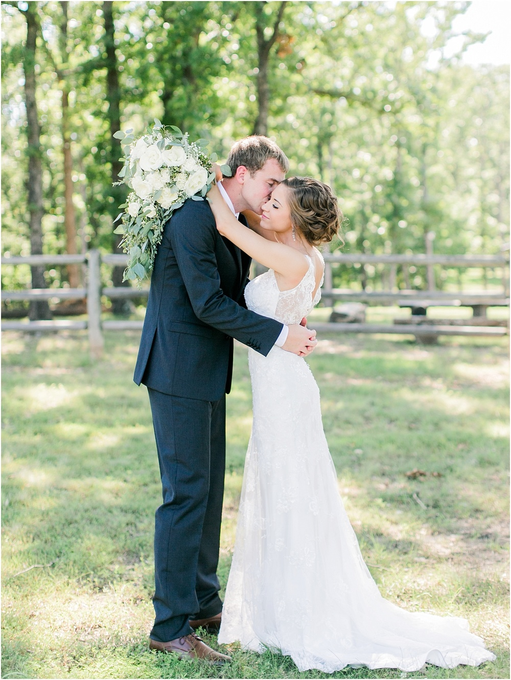 Best Springfield MO Floral Design by He Loves Me Flowers | Dress by Norman's Bridal Springfield, Missouri | Weathered Wisdom Barn in Preston, Missouri