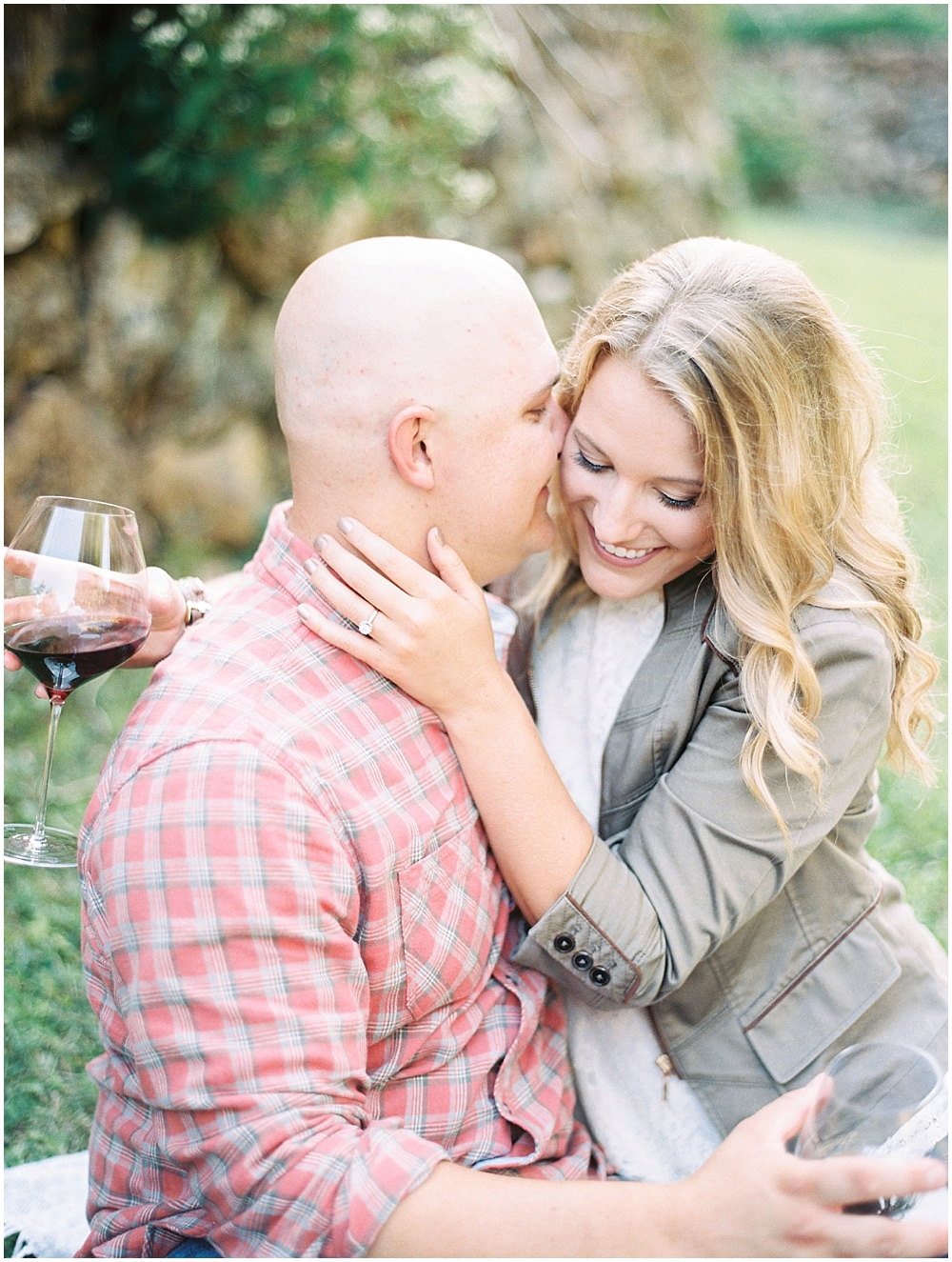 Romantic picnic with wine for an engagement session