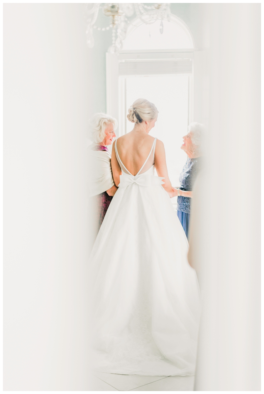 Light and Airy Photos of the bride in front of a window_0016.jpg