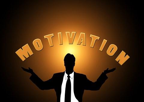 motivation - man holding sign