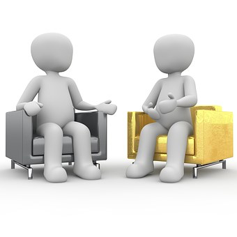 interview figures - 2 sitting in chairs talking