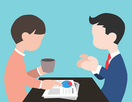 coworkers share a cup of coffee and information
