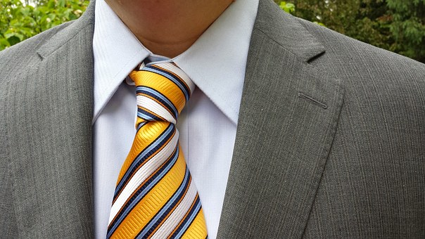 suit for man and colorful striped tie