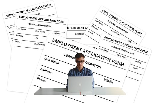 man completing online employment application
