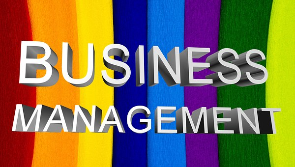 business management rainbow colored sign