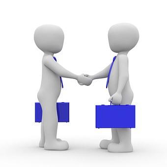 handshake between 2 professionals
