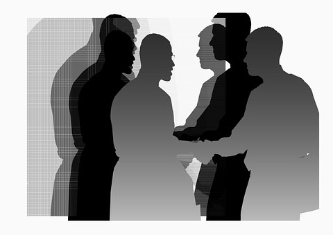 polite figures shaking hands