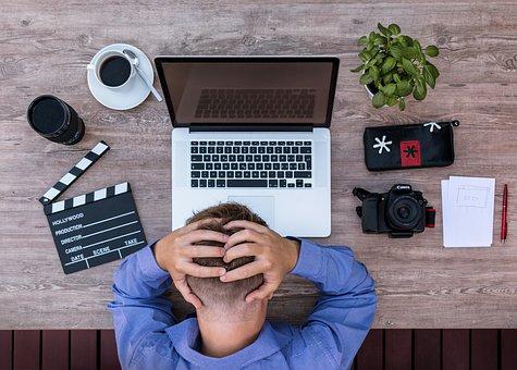 man experiencing work misery