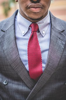 professional man in suit and red tie