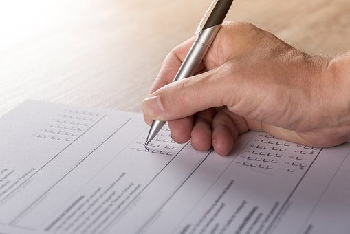 man completing assessment form