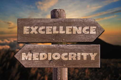 excellence versus mediocrity signage