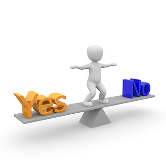 decision - figure on see saw - yes or no
