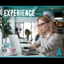 Experience - woman working at laptop
