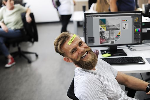 laughing man with be happy sticky note on forehead