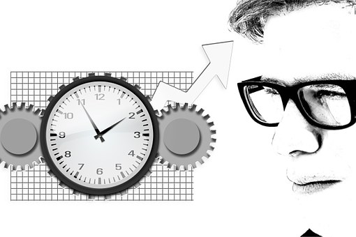 man thinking - wheels turning as clock is ticking