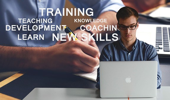 new skills - man at laptop learning - in training